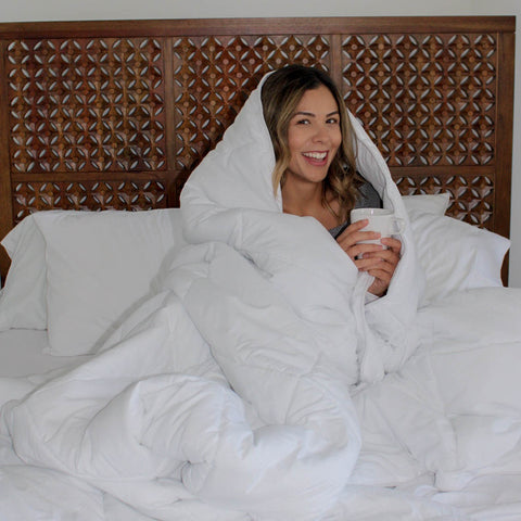 Lady snuggled in a Southshore Fine Linens Vilano Springs Plush Comforter
