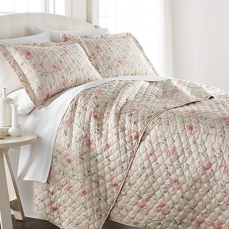 beige and pink floral print quilt set