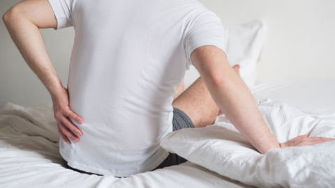 Man waking up with aching back