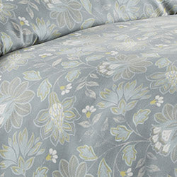 closeup of steel blue floral print pattern of reversible duvet set