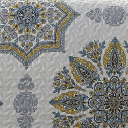 blue and yellow medallion print daybed quilt closeup