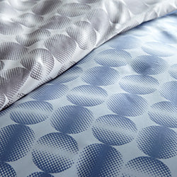 closeup of blue and silver modern geometric print pattern of microfiber duvet set