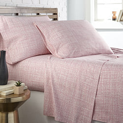 pink geometric print sheet and modern bedroom set