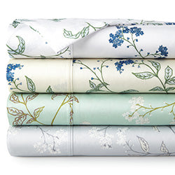 green, cream, white, and grey floral print pattern cotton sheet set stack