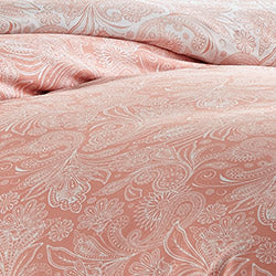 pink and white paisley print comforter pattern closeup