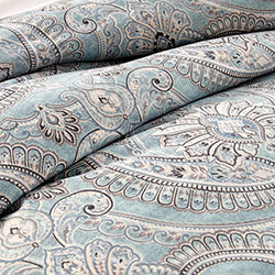 blue and grey paisley print comforter pattern closeup
