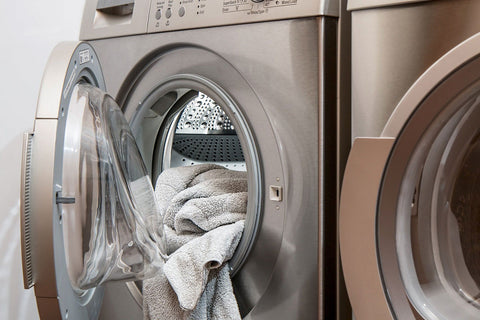 Image of washing machine with laundry in it.