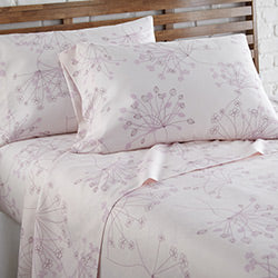 pink floral print sheet and modern bedroom set
