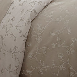closeup of pink floral print pattern comforter and sheet