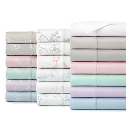 white, beige, grey, pink, green, lavender, blue, and floral print cotton modern sheet set stack