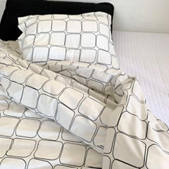 black geometric pattern sheet, black quilt, and white sheet set