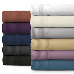 red, purple, blue, grey, black, white, beige, gold, and lavender pleated deep pocket sheet set stack