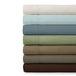 beige, blue, green, and brown pleated detail sheet set stack