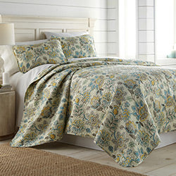 cream floral print quilt and farmhouse bedroom set