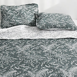 teal and white floral print quilt and farmhouse bedroom set