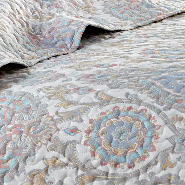 Boho paisley quilt embroidered detail closeup