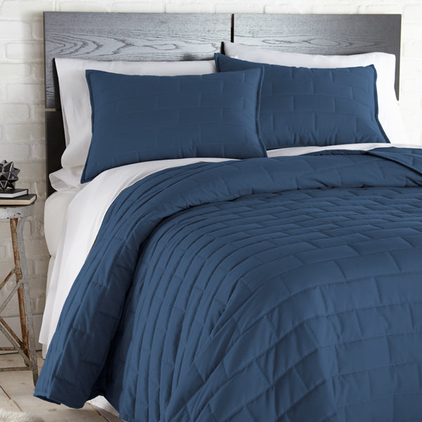 blue geometric embroidered and modern bedroom quilt set