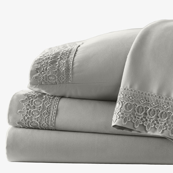 four piece grey lace sheet set stack