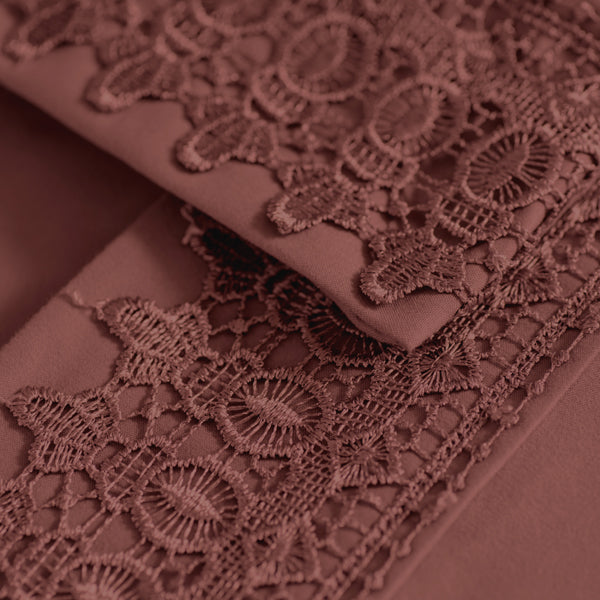 closeup of red embroidered lace detail sheet set
