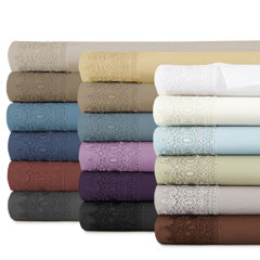 beige, brown, blue, red, grey, gold, teal, lavender, purple, black, white, and grey pillowcase stack with lace embroidered detail