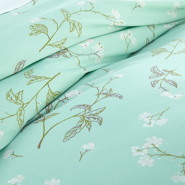 closeup of green floral print pattern of cotton duvet cover