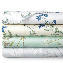 cream, green, grey, and white cotton sateen pillowcase stack