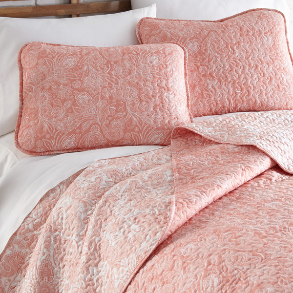 pink and white paisley print quilt and sham set