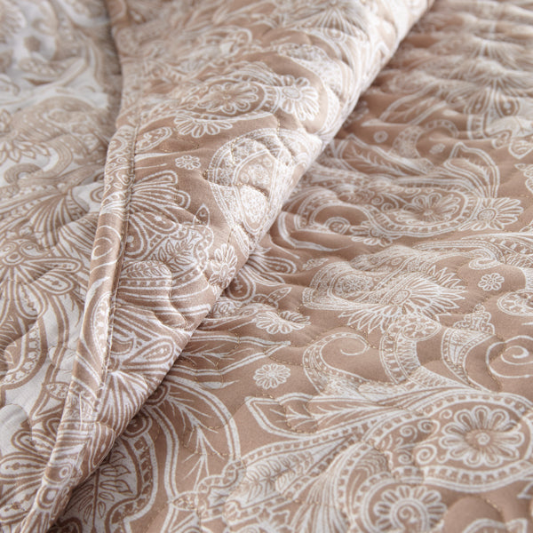 taupe and white paisley print quilt set pattern and embroidered detail closeup