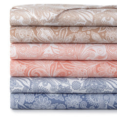 taupe, white, pink, and blue paisley print pillowcase stack
