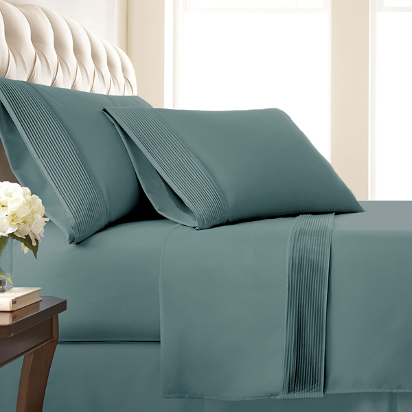 teal pleated sheets and traditional bedroom set