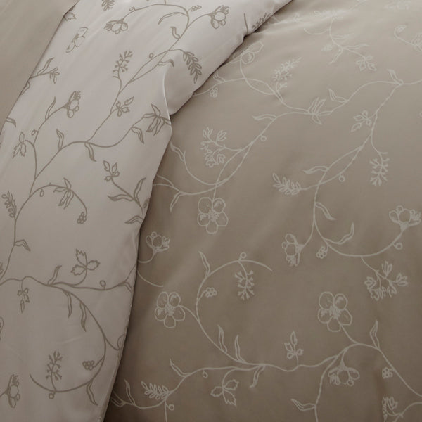taupe and white floral print duvet cover pattern closeup