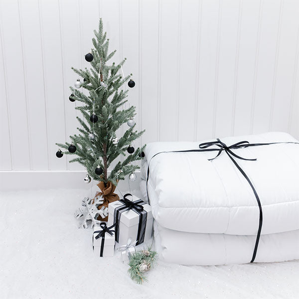 folded vilano comforter set under christmas tree