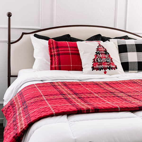 vilano comforter set with plaid quilt set folded across
