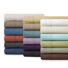 beige, brown, blue, red, grey, gold, teal, lavender, purple, black, white, and grey pleated pillowcase stack