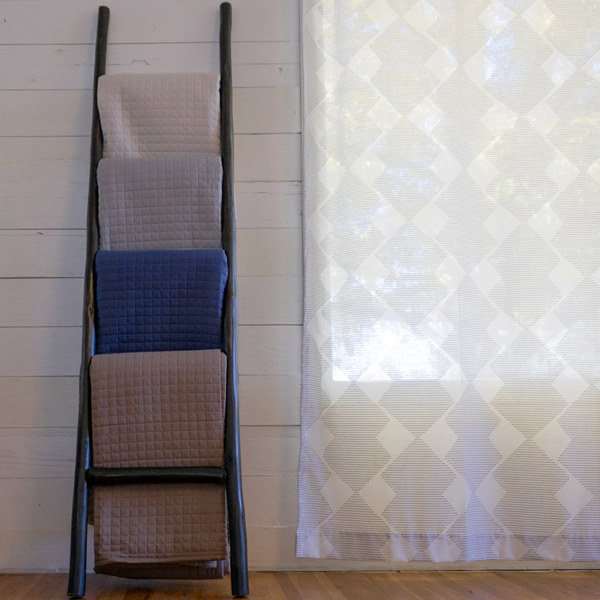 black, blue, beige, and grey quilt ladder set