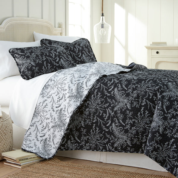 black and white floral print quilt and farmhouse bedroom set