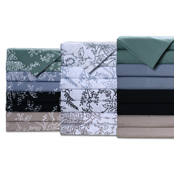 taupe, blue, teal, black, white, and floral print sheet set stack