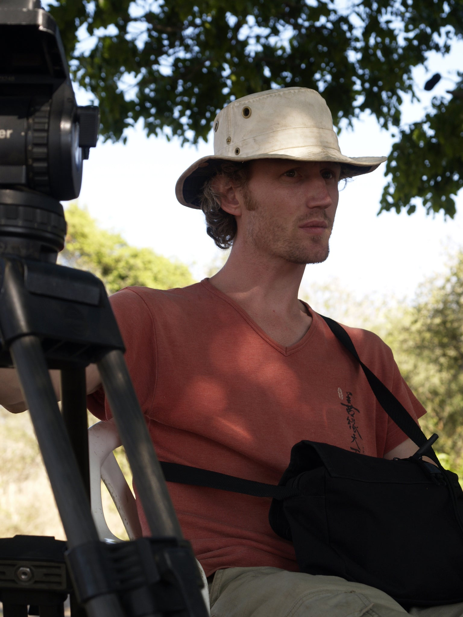 man wearing a hat with a camera