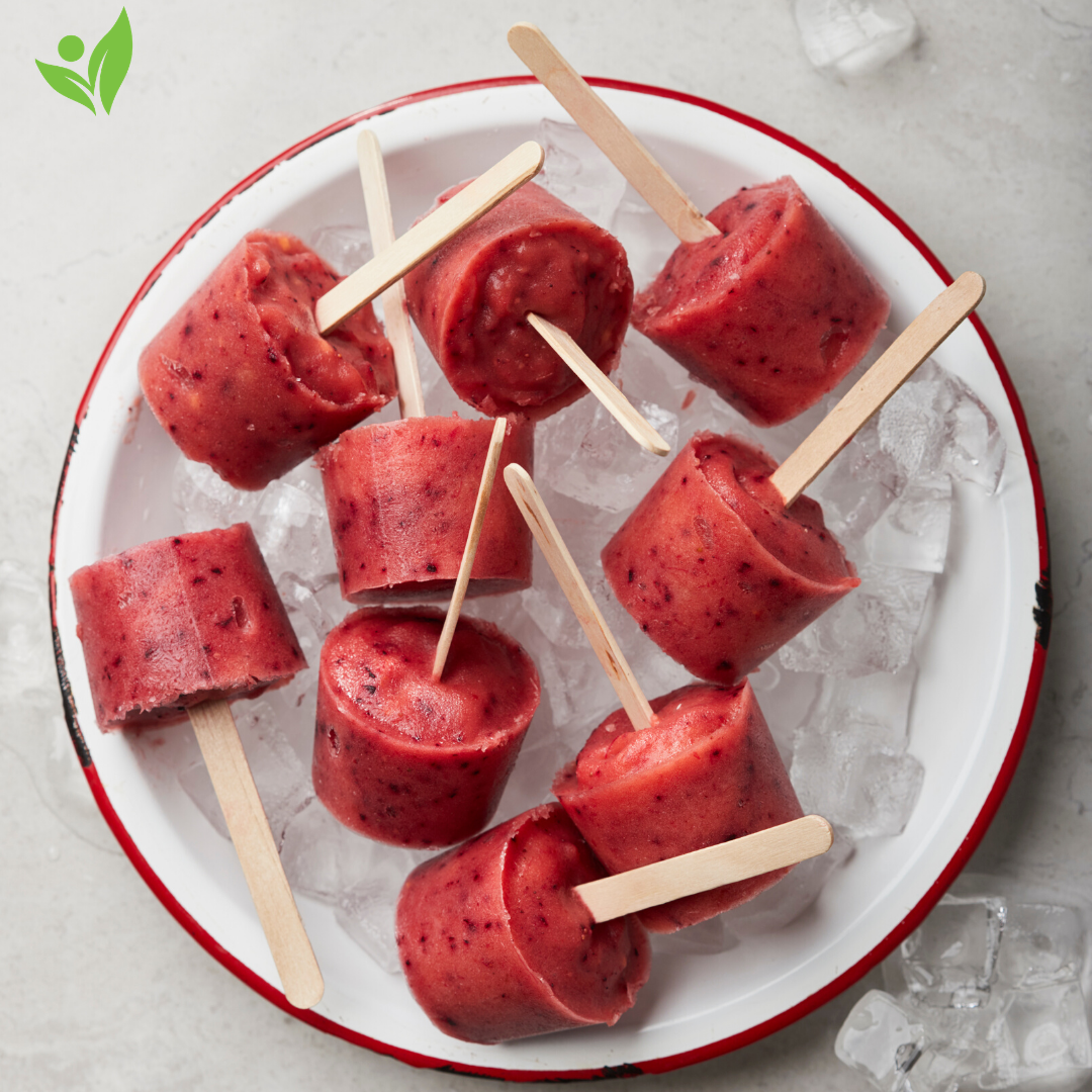 red fruit popsicles in a bowl of ice