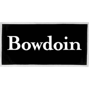 Rectangular black felt banner with white trim and brass grommets in the upper corners. A large BOWDOIN wordmark is imprinted on it in white.