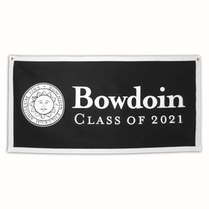 Black oblong felt banner with white trim. White Bowdoin sun seal on left side, right side has white imprint of BOWDOIN wordmark over CLASS OF 2021.