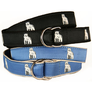 Stacked D-ring belts in black and light blue. The ribbon is pattered with repeating polar bear mascots.