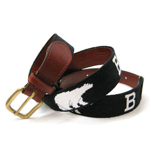 A brown leather belt with a needlepointed design of white Bs and white polar bears on a black field.