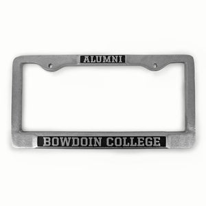 Pewter license plate frame with an embossed imprint of ALUMNI in a black rectangle on the top, and the words BOWDOIN COLLEGE embossed in a black rectangle on the bottom.