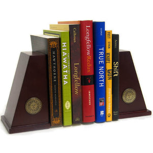 Wooden bookends with minted metal sun seal medallions, with books by Bowdoin authors between them.
