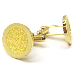 Gold cufflinks with engraved Bowdoin College seal.