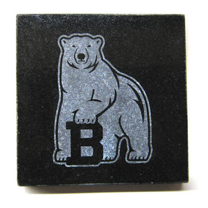 Square black granite coaster with etched polar bear mascot.