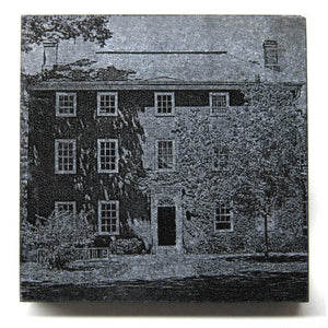 Square black granite coaster with etched Mass Hall.