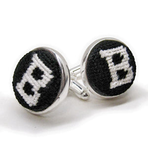 Silver cufflinks with needlepointed tops, black with white Bowdoin B.