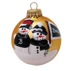 Gold glass ball ornament with two snowmen side by side. One has a B on its sweater, the other holds a pennant with the word BOWDOIN.